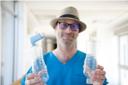 Image of Prof Mike Levin shows off the innovative bottle spacer